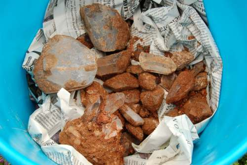 Some of the treasure we found at the mine.  This is just the top layer of crystals in this bucket.  We place newspaper between each layer to protect the crystals.